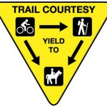 A typical trail courtesy sign