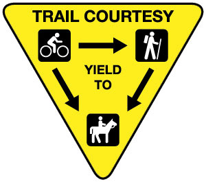 A typical trail courtesy sign.
